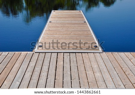 Wooden dock in a lake in a sunny day #1443862661