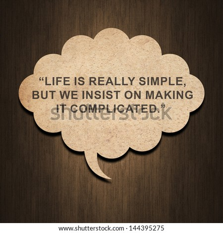 Inspirational quote by Confucius on speech bubble paper on wood background
