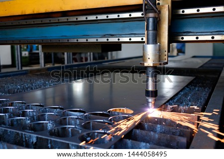 Metal cut process with sparks, plasma cutting machine, thick metal cutting,  carpentry metalwork industry, spark blaze #1444058495