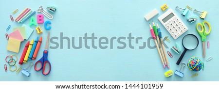 education and back to school concept. stationery over wooden blue background. top view, flat lay Royalty-Free Stock Photo #1444101959