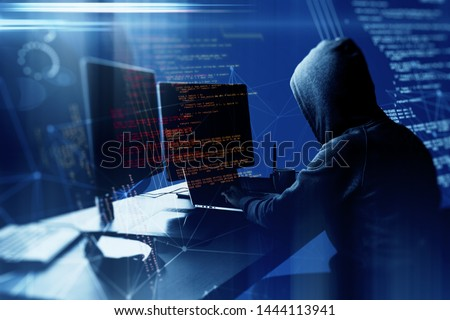 Hacker using laptop computer with html code and map. Attack and programming concept. Double exposure
