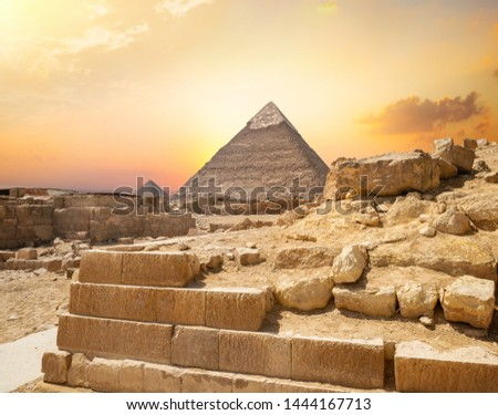 Egyptian pyramid in sand desert and clear sky #1444167713