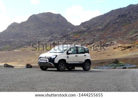 Kleifarvatn, Iceland  - June 19, 2019 - A 4-door white Fiat 500 on the road by Route 42  #1444255655