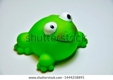 Green rubber frog toys with white background