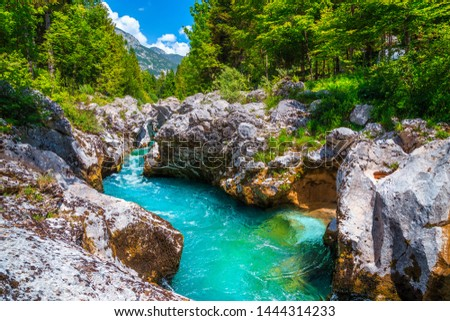 Popular rafting and kayaking place in Europe. Well known recreation place and kayaking destination. Amazing turquoise Soca river and gorge, Bovec, Slovenia, Europe #1444314233