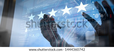 Five stars (5) rating with a businessman is touching virtual computer screen.For positive customer feedback and review with excellent performance. #1444360742