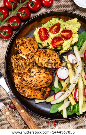 Grilled chicken fillet and vegetables on wooden table #1444367855
