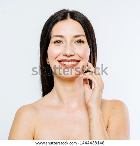 Portrait of beautiful brunette model with braces on white background #1444438148