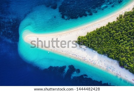 Croatia, Hvar island, Bol. Panoramic aerial view at the Zlatni Rat. Beach and sea from air. Famous place in Croatia. Summer seascape from drone. Travel - image #1444482428