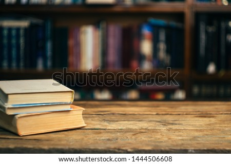 The book in the library (school, university, college) on the table. Reading, literature, learning and back to school concept. Copy space. #1444506608