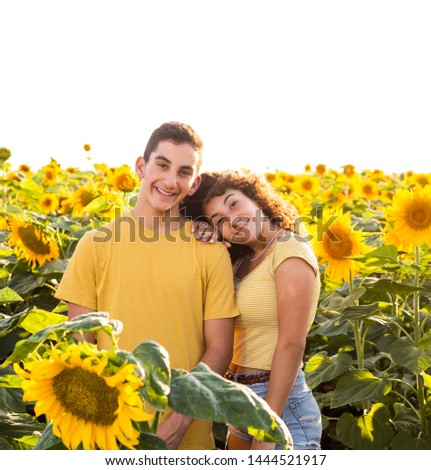 Teenager couple/siblings in a sunflowers field. #1444521917