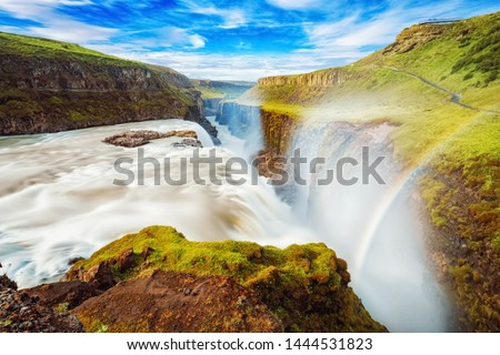 Iceland, Gullfoss waterfall. Captivating scene with rainbow of Gullfoss waterfall that is most powerful waterfall in Iceland and Europe. Picturesque summer scene with amazing Icelandic waterfall. #1444531823