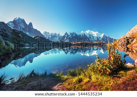 Sunrise  panorama of the Lac Blanc lake with Mont Blanc (Monte Bianco) on background, Chamonix location. Beautiful outdoor scene in Vallon de Berard Nature Reserve, France #1444535234