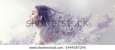 Beauty Model Girl with Lavender flowers double exposure art design. Beautiful young brunette woman with flying long hair profile portrait. Fantasy Watercolor. Nature cosmetics concept, make-up #1444587296