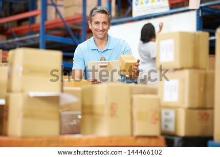 Workers In Warehouse Preparing Goods For Dispatch #144466102