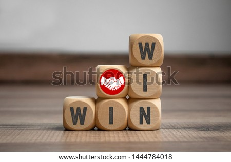 Cubes and dice with handshake icon and win-win-situation  Royalty-Free Stock Photo #1444784018