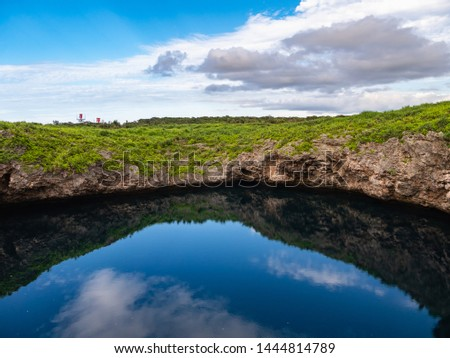 Toriike Pond is a pond located in the western part of Shimojijima Island, Miyakojima, Okinawa, Japan. It looks like two ponds lined up next to each other but they are actually connected underground. #1444814789