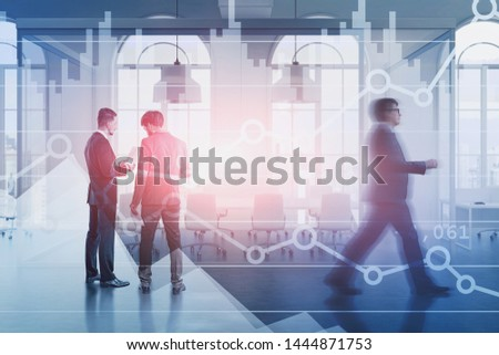 Business people discussing documents in office conference room with double exposure of diagrams. Concept of trading and stock market. Toned image blurred #1444871753
