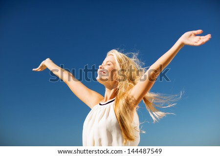 lifestyle concept - beautiful happy woman enjoying summer outdoors Royalty-Free Stock Photo #144487549