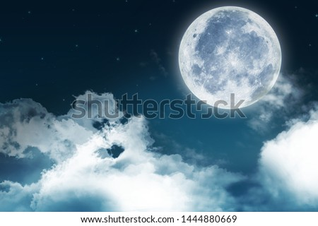 Super moon. a bright full moon and stars above the seascapes at night. Background to the tranquility of nature, outdoor at night. #1444880669