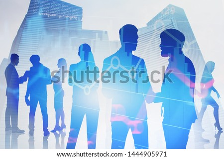 Silhouettes of business people talking and shaking hands in modern city with double exposure of diagrams. Concept of teamwork and stock market. Toned image #1444905971