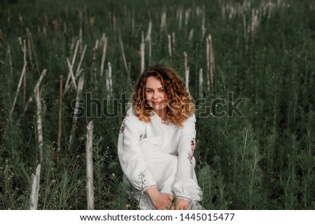 beautiful girl dressed in a shirt alone in the field;  #1445015477
