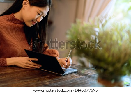 writer beautiful asian woman enjoy weekend with notebook and diary #1445079695