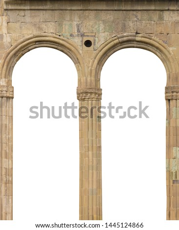 Elements of architectural decorations of buildings, balconies and arches, gypsum stucco, plaster patterns. On the streets in Georgia, public places. #1445124866
