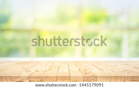 Empty wood table top on blur abstract green garden from window view in the morning. For montage product display or design key visual layout #1445179091
