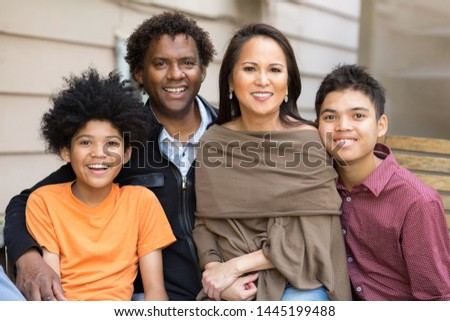 Happy mixed race family laughing and smiling. #1445199488
