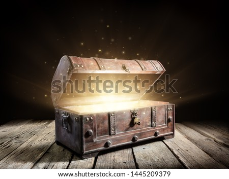 Treasure Chest - Open Ancient Trunk With Glowing Magic Lights In The Dark  #1445209379