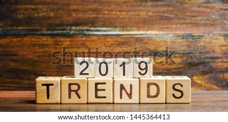 Wooden blocks with the word Trends 2019. Main trend of changing something. Popular and relevant topics. New ideological trends of fashion. Recent and latest trend. Evaluation methods. Fashionable #1445364413