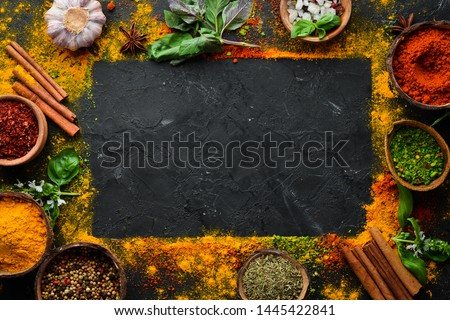 Colorful herbs and spices for cooking. Indian spices. On a black stone background. Top view. #1445422841