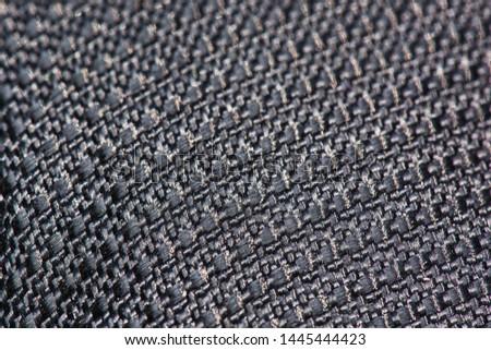 Macro Detailed Rough Textile Texture Background. Dark Monochrome Linen. Grey Fabric Neutral Backdrop for Object Photoshoot, Presentation or Wallpaper Design. Seamless Grunge Cloth Closeup