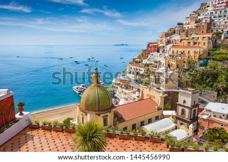 Beautiful Positano on hills leading down to coast, comfortable beaches and azure sea on Amalfi Coast in Campania, Italy. Amalfi coast is popular travel and holyday destination in Europe. #1445456990