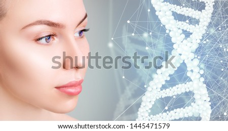 Young woman near digital bubble DNA stems. Over blue background. Beauty science concept. #1445471579