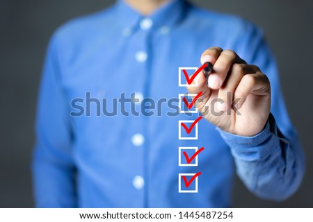 Checklist concept, Businessman checking mark on the check boxes with marker red #1445487254