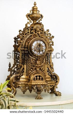 Antique mechanical clock made of metal #1445502440