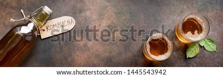 Kombucha or cider fermented drink on rustic background, copy space, banner. Heathy probiotic drink - kombucha. #1445543942