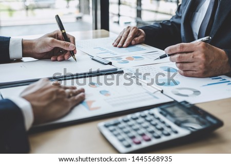 Two executive discussing company growth project success financial statistics, Partner meeting professional investor working start up project for both company with document, laptop and digital tablet. #1445568935