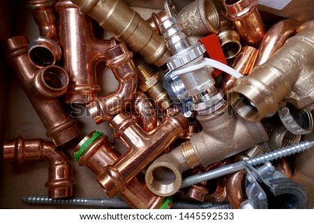 Small material for plumbers and heating installers. Copper, brass, steel, pipes, angles #1445592533