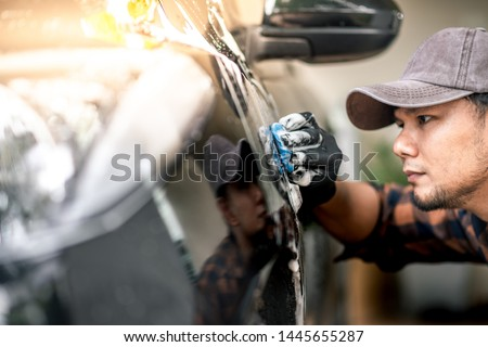 Washing the black car. Car cleaning and car care concept. #1445655287