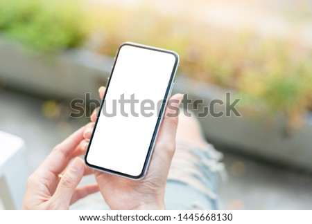 Mockup image screen cell phone.women hand holding texting using mobile at desk.with copy space,white blank space for advertise text.concept for contact business,people communication,technology device #1445668130