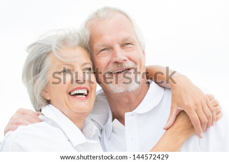 Happy and smiling couple in front of white sky #144572429