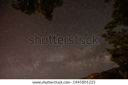 Night landscape with colorful Milky Way and yellow light at mountains. Starry sky with hills at summer. Beautiful Universe. Space background #1445801225