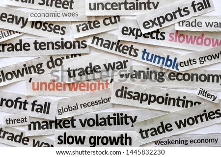 Newspaper cutout of headlines reporting on trade war and the impact on the economy and financial markets presently hogging major dailies and media. Concept for US versus China, Europe trade war. Royalty-Free Stock Photo #1445832230