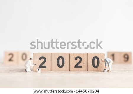 Miniature worker team painted number 2020 and remove number 2019  , Happy new year 2019 concept