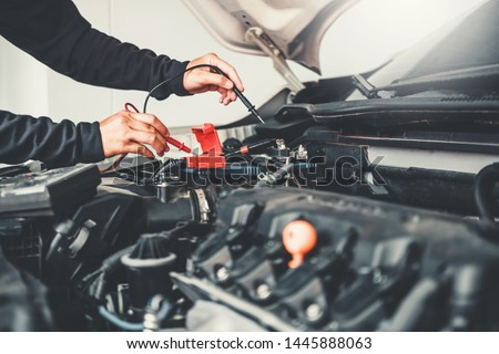 Technician Hands of car mechanic working in auto repair Service and Maintenance car battery #1445888063