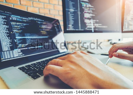 Developing programmer Team Development Website design and coding technologies working in software company office #1445888471