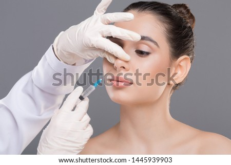 Plastic surgery of nose. Doctor filling injection into female nose, alternative rhinoplasty #1445939903